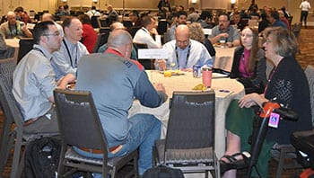 Event participants sitting together at a table